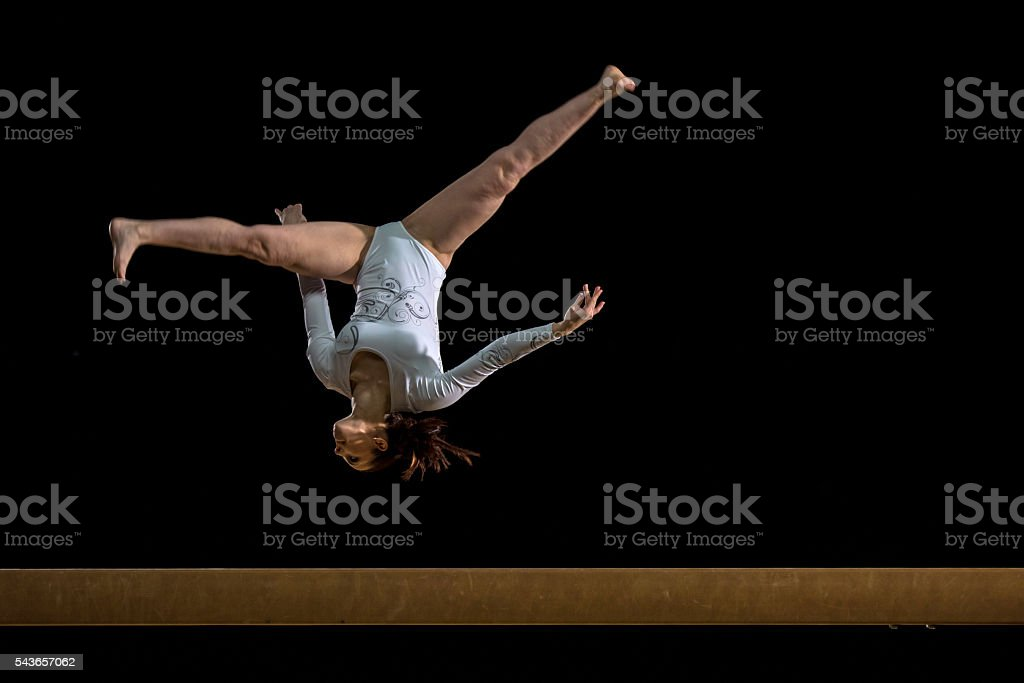 Female Gymnast on Balance Beam stock photo