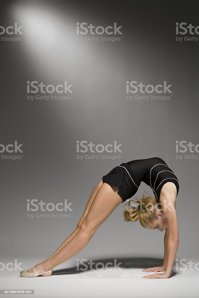 Female gymnast stretching, studio shot royalty-free stock photo