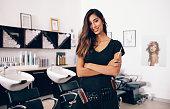 istock Female hairdresser standing in salon 853924196