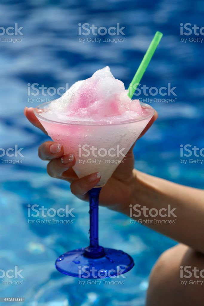 Female hand about a cocktail with an snow stock photo