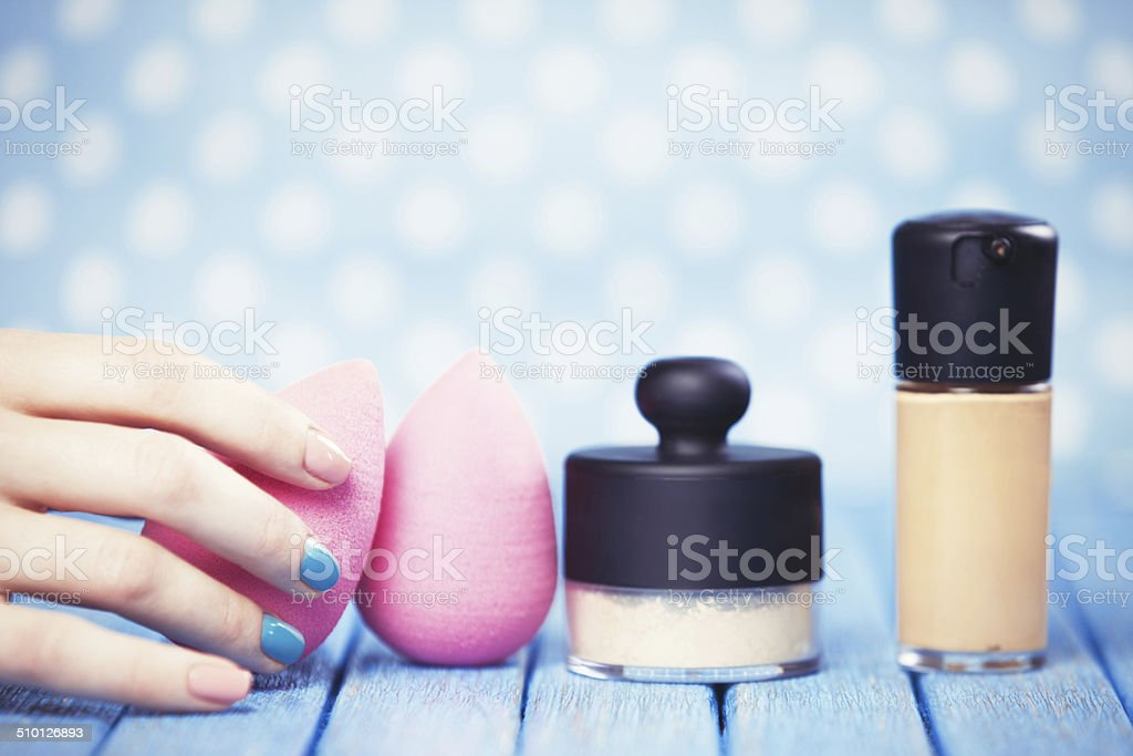 Female hand and beauty blender. stock photo