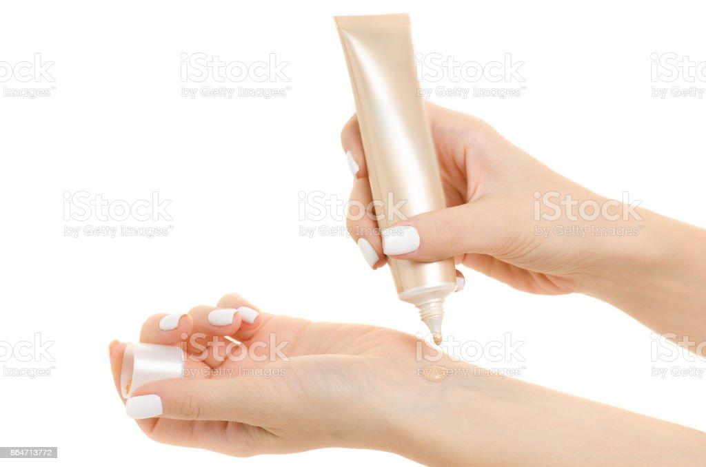 Female hand base cream beige – zdjęcie