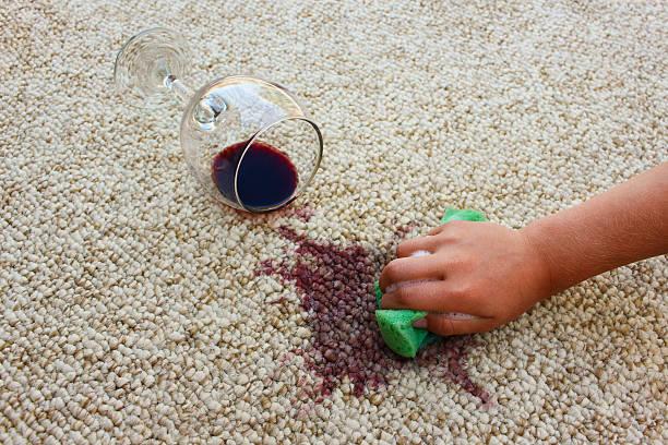 female hand cleans floor with sponge and detergent. - weinflecken entfernen stock-fotos und bilder