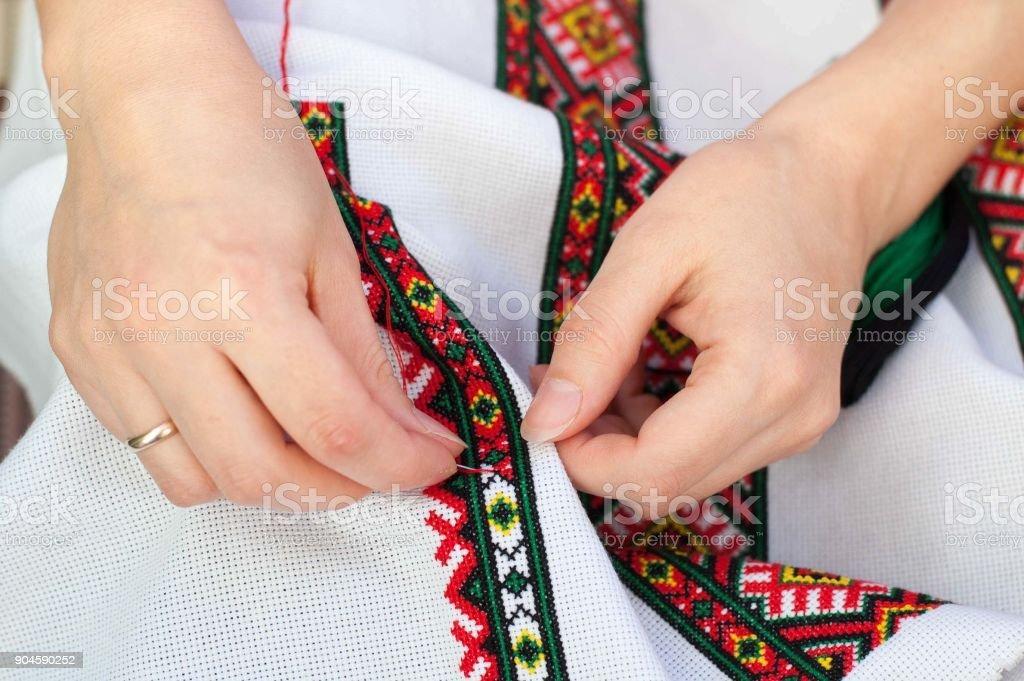 Female hand embroider at cross stock photo