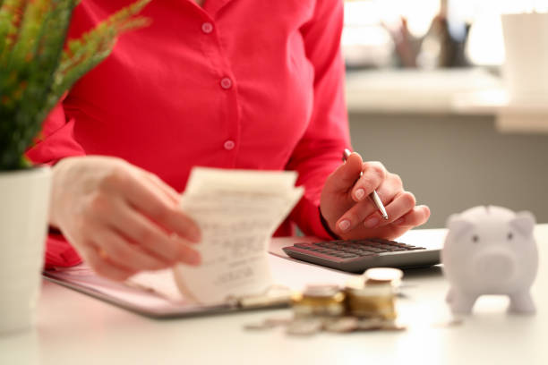 female hand financial inspector push key - holiday and invoice family foto e immagini stock