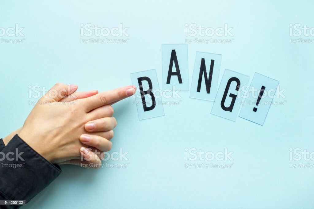 female hand folded in sign of gun with bang word stock photo more