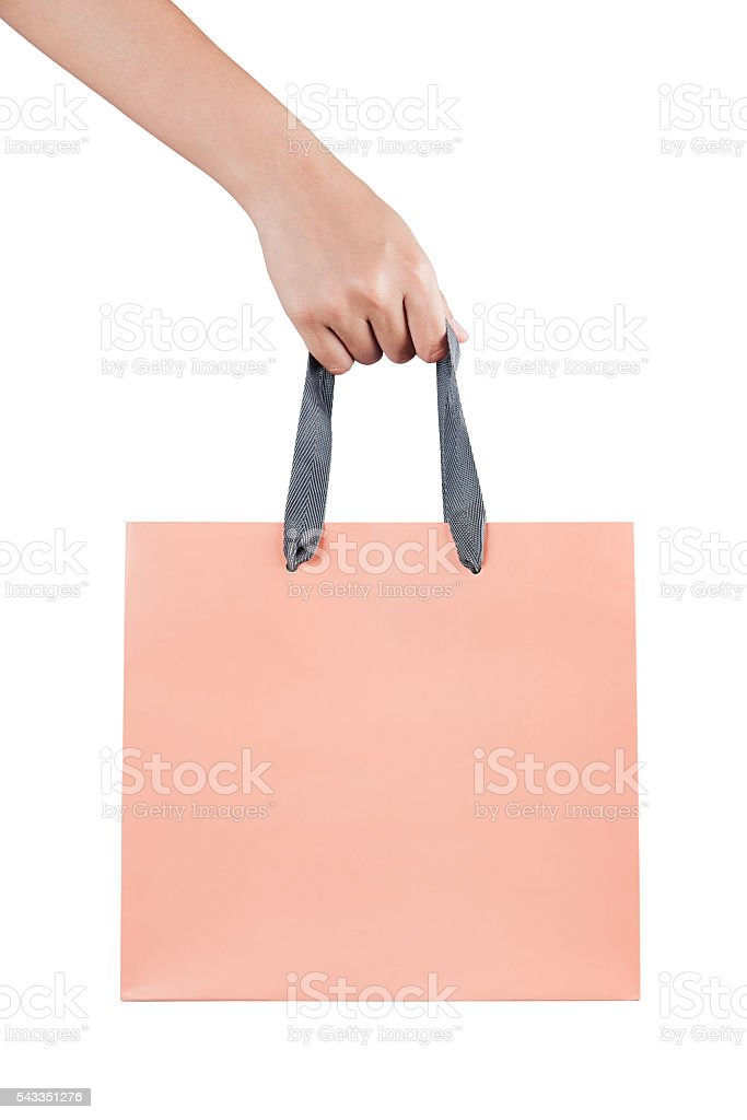 female(woman) hand hold a pink shopping bag(paper bag) stock photo