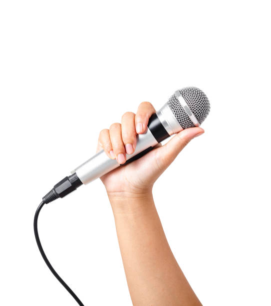 Female hand hold microphone isolated stock photo
