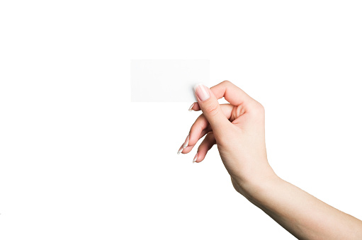 female hand holding a blank business card stock photo