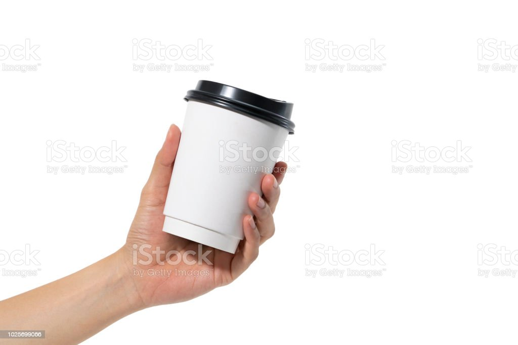 female hand holding a coffee paper cup isolated on white background. stock photo