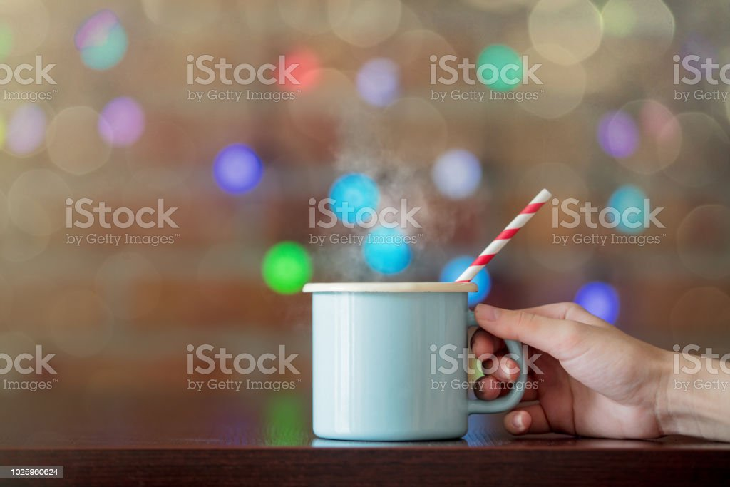 Female hand holding a hot cup of coffee stock photo