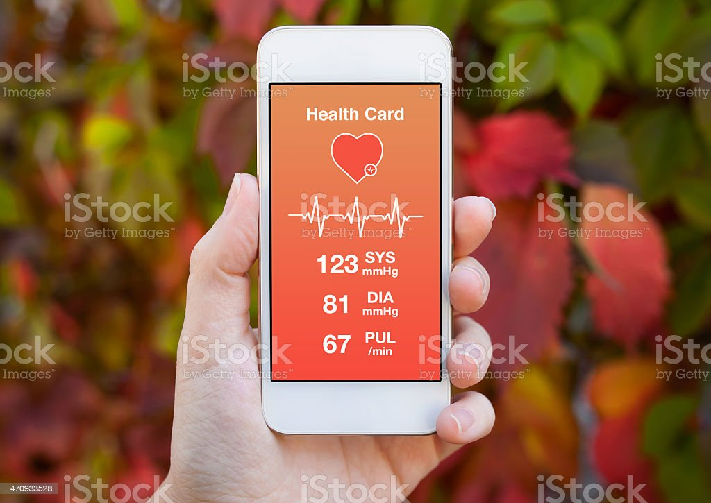 female hand holding a white phone with health card stock photo