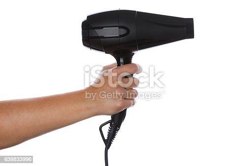 istock Female hand holding black hairdryer 639833996