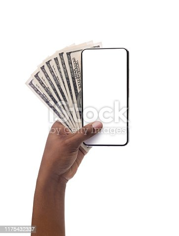 Female hand holding blank cellphone and bunch of dollar banknotes, isolated on white background