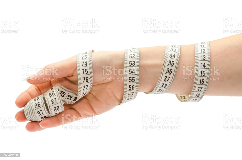 female hand holding centimeter to measure. stock photo