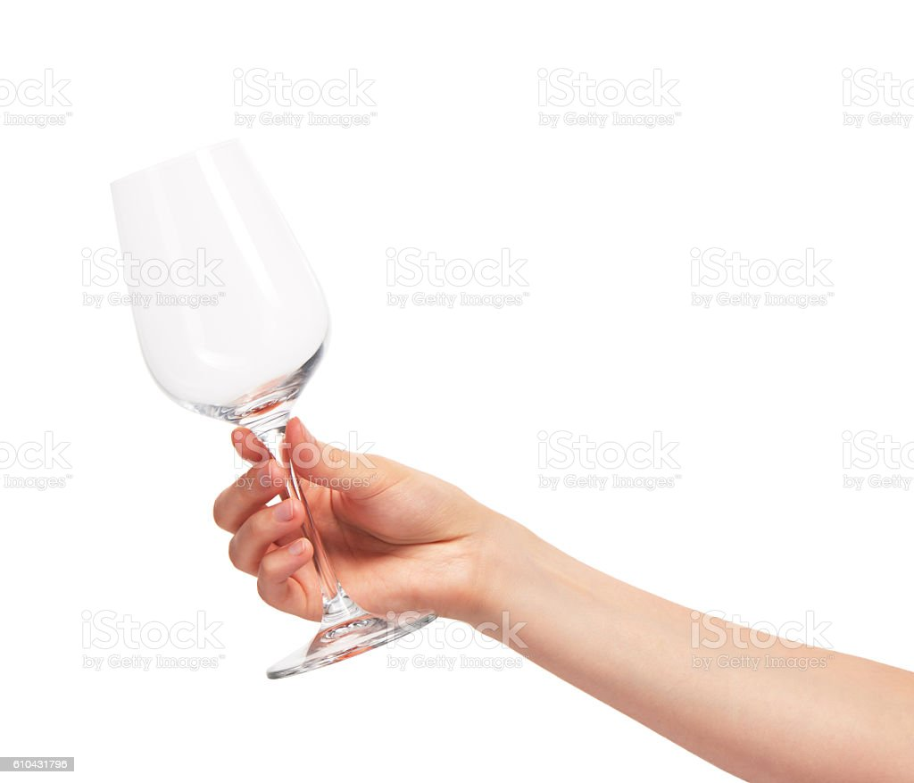 Female hand holding empty clean transparent wine glass stock photo