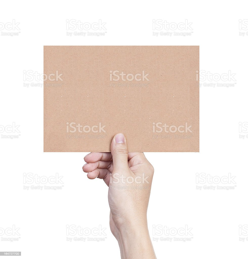 Female hand holding empty piece of cardboard isolated on white royalty-free stock photo