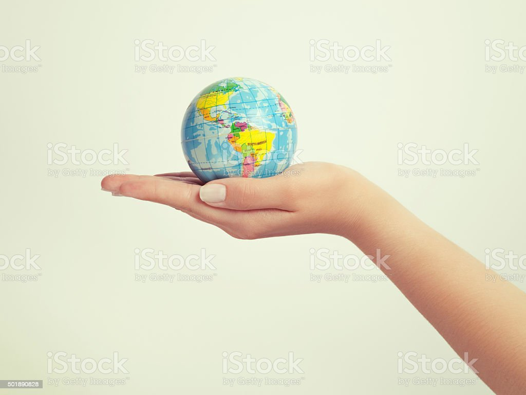 female hand holding globe. save the earth concept stock photo
