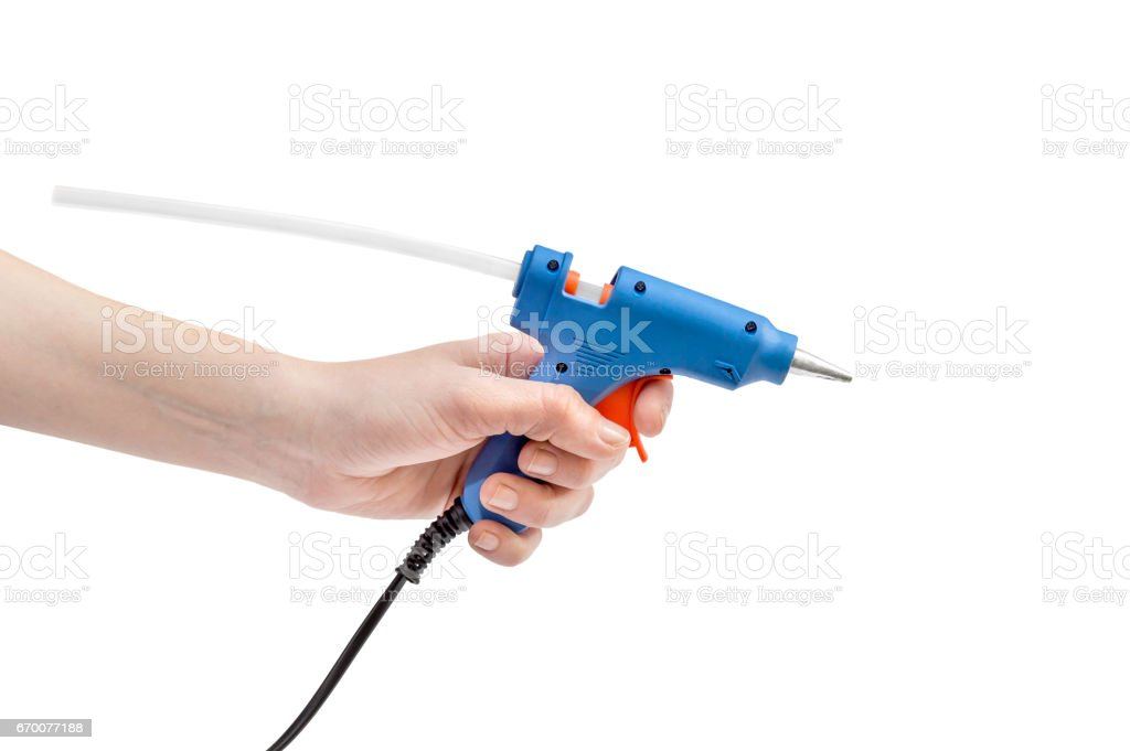 Female hand holding glue gun. Isolated on white. stock photo