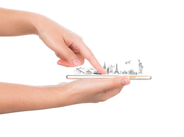Female hand holding gold mobile phone smartphone  travel around stock photo