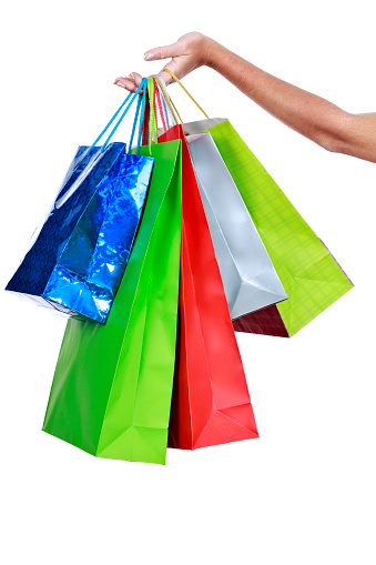 Female hand holding group of shopping bags