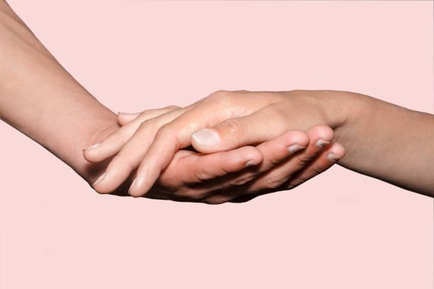 Female hand holding male hand on background picture id1049331922?b=1&k=6&m=1049331922&s=612x612&w=0&h=u9gdxtwkwppukf4tt hdtct26fbwqqnvyadmyo6xpsy=
