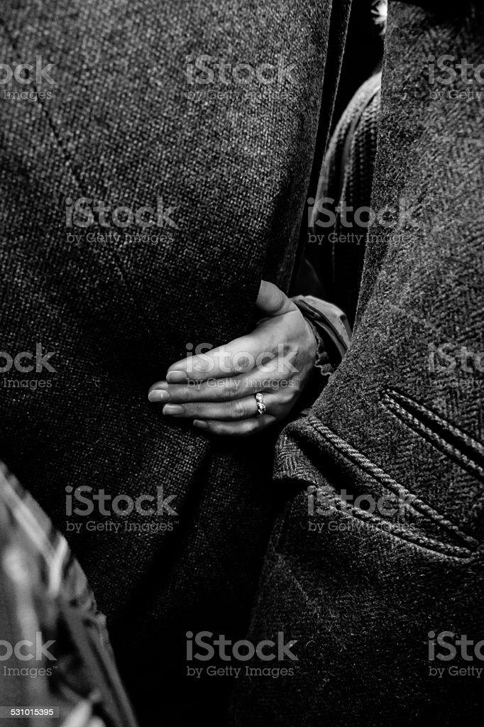 Female hand holding man stock photo