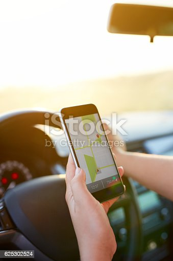 istock Female hand holding mobile phone with map gps navigation 625302524