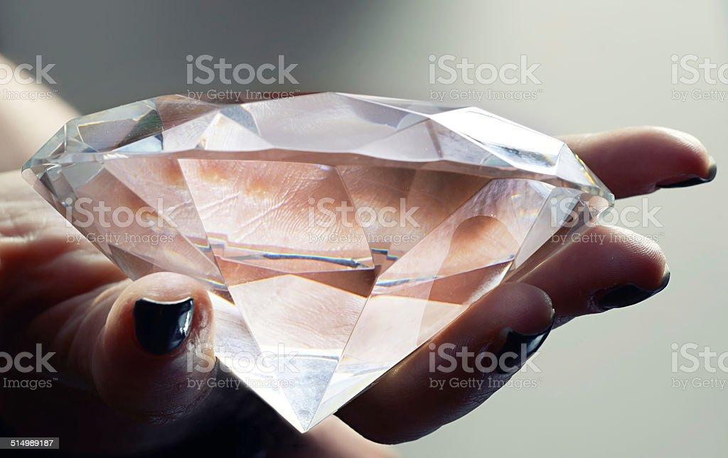 Female Hand Holding Oversized Diamond stock photo