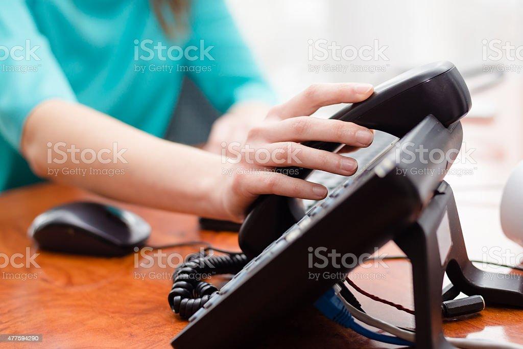Female hand holding phone stock photo