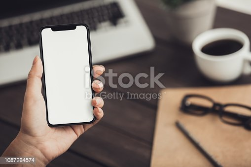 istock Female hand holding phone with app health tracking activity 1087264574