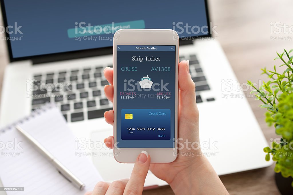 female hand holding phone with online ship ticket and notebook – Foto