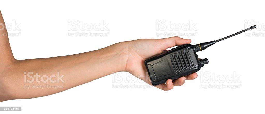 Female hand holding portable radio transmitter stock photo