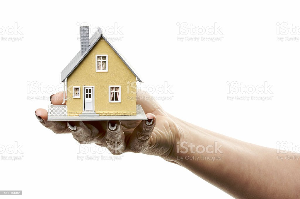 Female Hand Holding Small House royalty-free stock photo