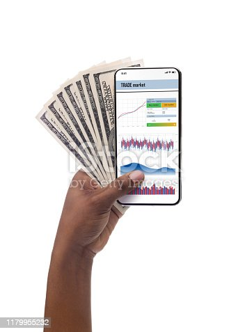 Black female hand holding smartphone with trade market application and cash