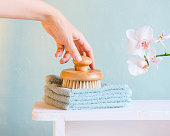 istock Female hand holding the brush for dry massage 1170123166