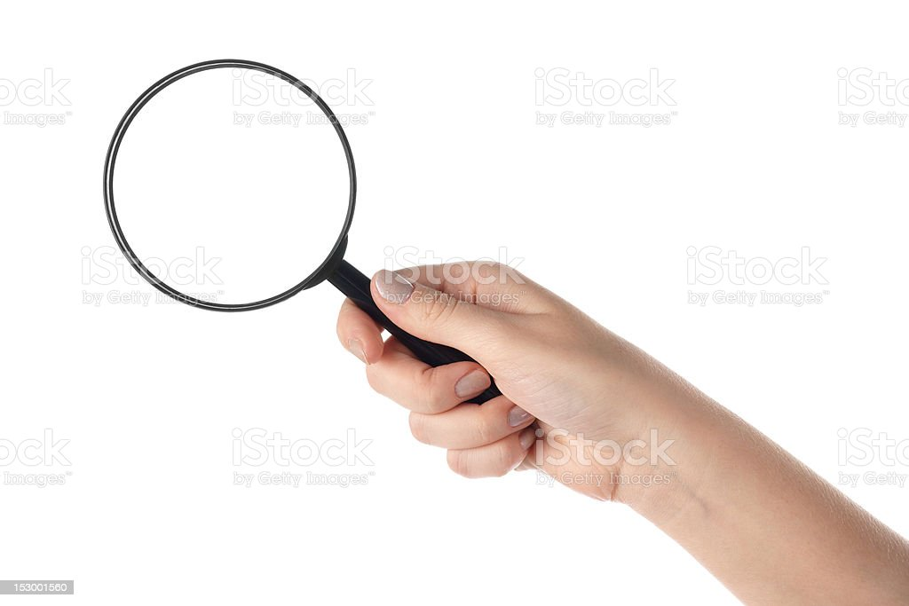 Female hand holding the magnifying glass (isolated) stock photo