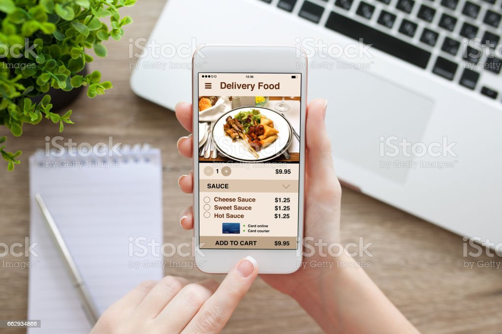 female hand holding white phone with app delivery food screen stock photo
