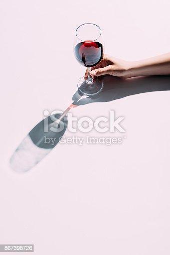 istock Female hand holding wineglass 867398726