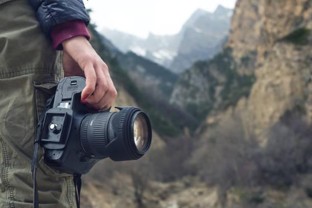 Female hand holds a camera against a mountain landscape picture id866954210?b=1&k=6&m=866954210&s=612x612&w=0&h=odyjlteqm2tnqxavj4hnkcjuz8zfjorkkszvoujc ii=