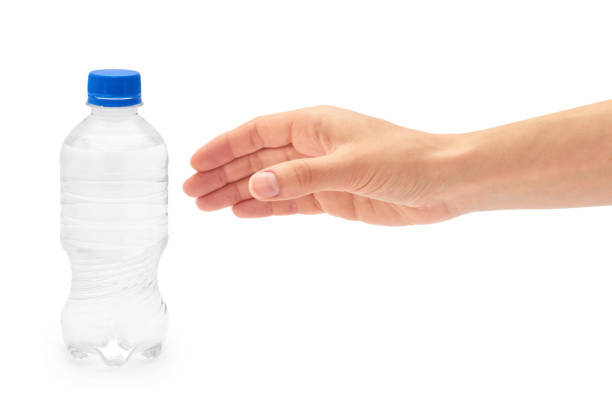 female hand holds clean and fresh water packed in a plastic bottle. isolated on white background - gripping stock photos and pictures