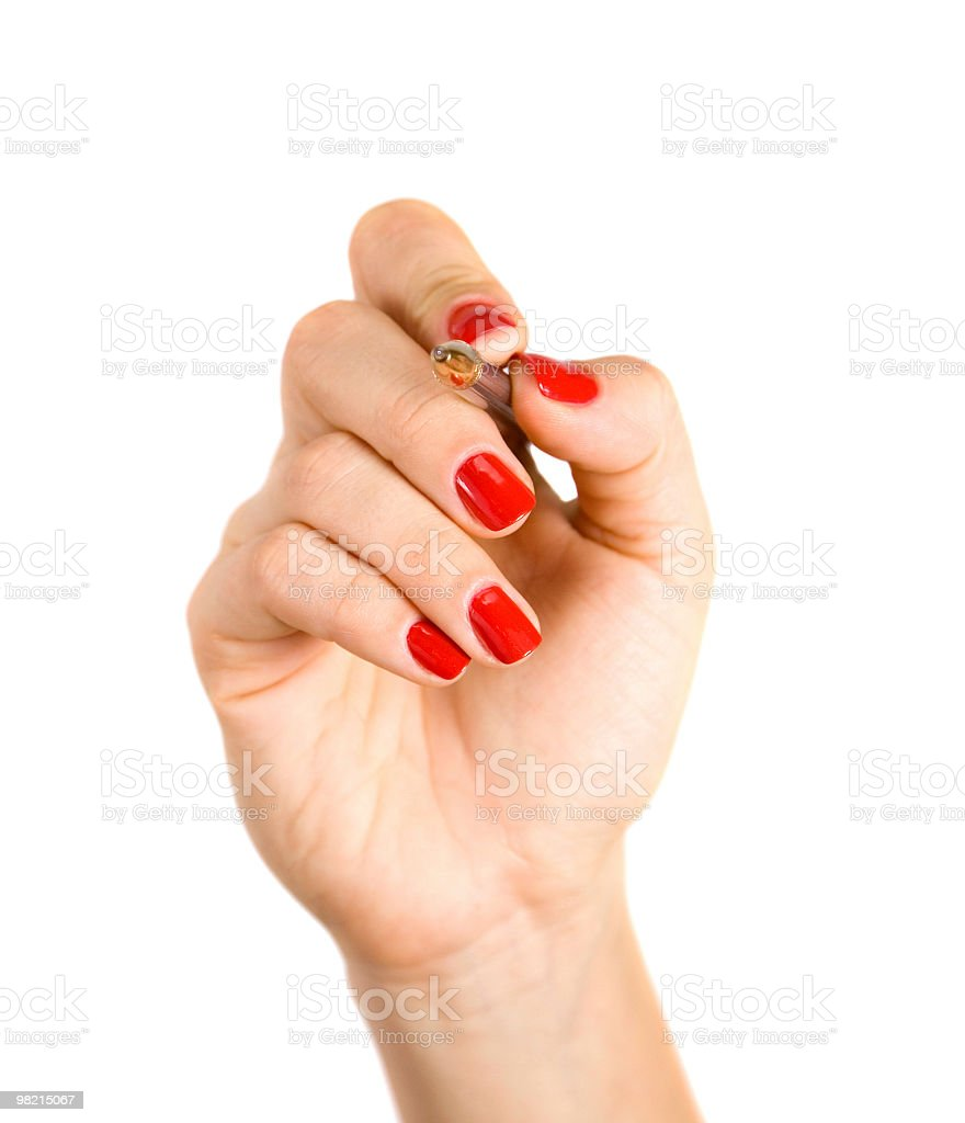 Female hand holds the pen royalty-free stock photo