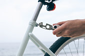 Female hand holds the tool to fix bike
