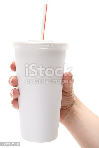 Female hand holding a white disposable soda cup with drinking straw. Isolated on a white background.