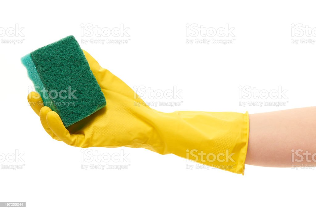 Female hand in yellow protective glove holding green cleaning sponge stock photo
