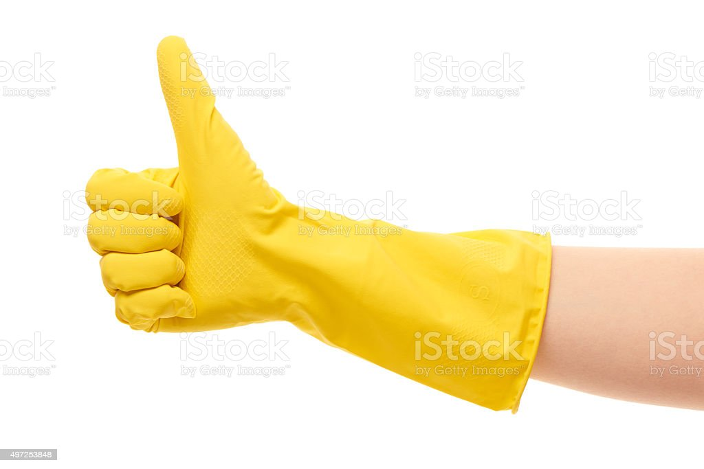 Female hand in yellow protective glove showing thumbs up sign stock photo