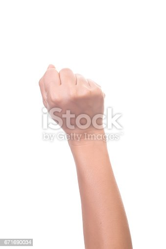 istock Female hand is showing zero fingers isolated on white background 671690034