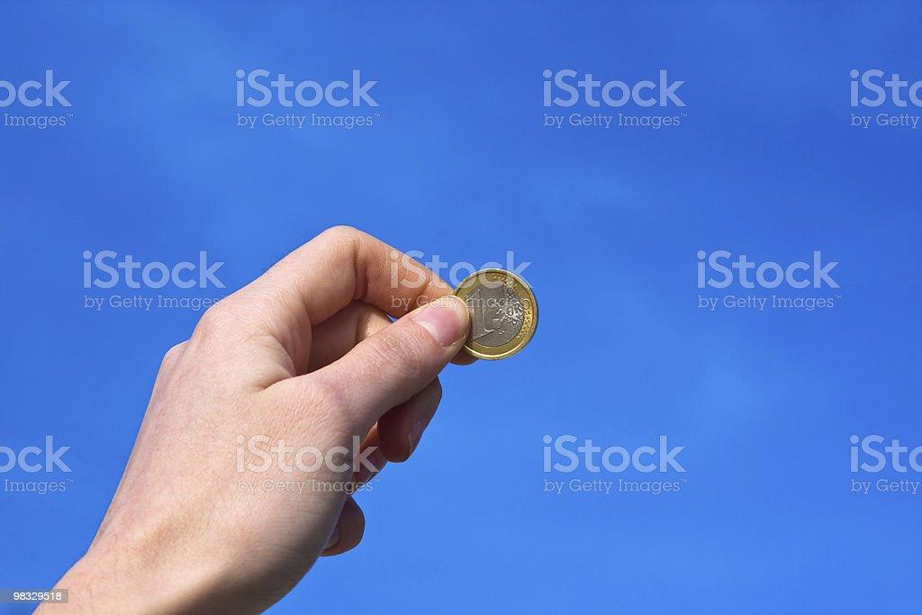 Female hand lending an euro coin royalty-free stock photo