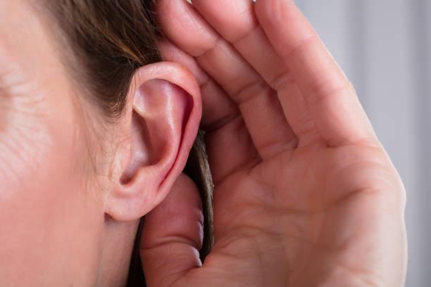 Female Hand On An Ear stock photo