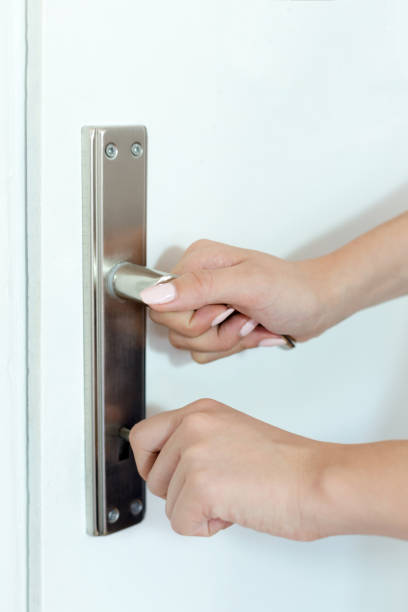 female hand opening a door - hand grip stock photos and pictures